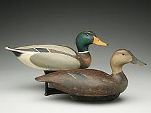 Two decoys that are reproductions of Ward Brothers 1936 models.