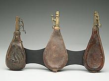 Three leather shot flasks, last half 19th century.
