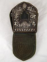 A Tibetan portable shrine in padded embroidered