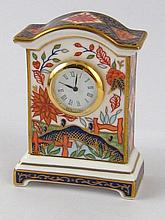 A Royal Crown Derby mantel clock, approx 7.5cm, in