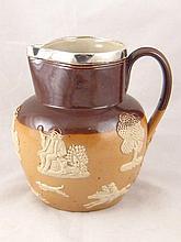 A Doulton ceramic harvest jug with hallmarked