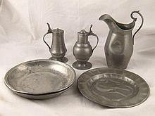 A small collection of pewter including a jug and