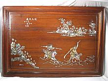 A Chinese hardwood wall plaque inlaid with engrave