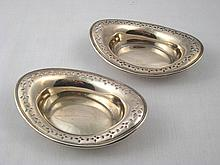 Tiffany. A pair of heavy gauge bonbon dishes with