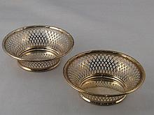 A pair of sterling silver pierced baskets with rib