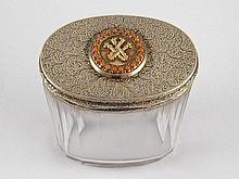 A silver mounted panelled oval glass jar, the lid