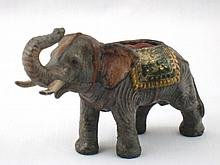 An Austrian cold painted bronze elephant pin cushi