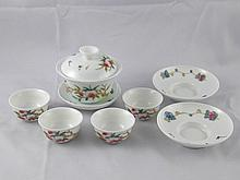 A set of Chinese tea bowl, cover and saucer, toget