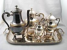 A French four piece silver plated tea set and matc