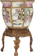 A LARGE CHINESE FAMILLE ROSE PORCELAIN FISHBOWL AND GIL