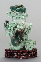 A CHINESE CARVED JADE COVERED KORO WITH STAND, late 19t