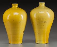 A PAIR OF CHINESE YELLOW PORCELAIN VASES 14 inches high