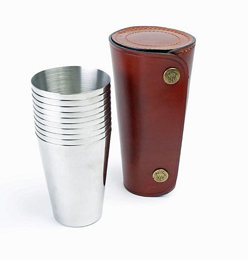 † RAY PAVON A NEW AND UNUSED SET OF EIGHT STAINLESS STEEL TUMBLERS,