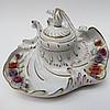 An ornate German flower encrusted inkwell and