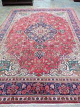 A Najafabad carpet with burgundy ground. 280cm x 283cm