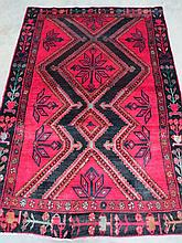 A Hamadan traditional style rug, red ground with black and orange pattern, measuring 200 x 142cm.