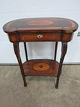 A delightful musical themed rosewood side table inlaid with satinwood, musical instruments and sheet music within a central cartouche raised over shaped and reeded legs united by a solid undershelf complete with single drawer stamped Pratt & Son,
