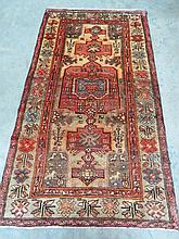 A patterned Hamadan style rug measuring 190 x 107cm.