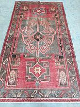 A patterned Hamadan rug measuring 235 x 135cm.