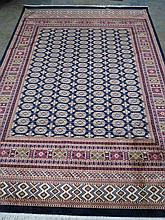 A blue ground Bokhara rug. 2.8m x 2m
