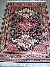 A blue ground Caucasion rug. 1.9m x 1.4m