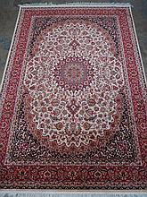 A beige ground Keshan rug. 2.3m x 1.6m