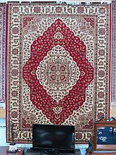 A red ground Kum carpet 280cm x 200cm.