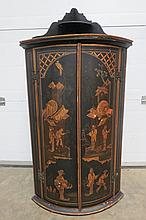 A Chinoiserie corner cabinet.