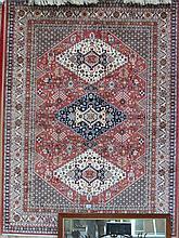 A tan ground caucasian rug, 190cm x 140cm.