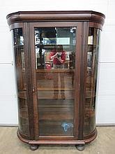 An oak glazed door cabinet.