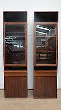 An impressive pair of Danish contemporary rosewood display cabinets by Scanflex, single glass door opening to reveal shelves within, drawer and solid door under and each measuring 59 x 39 x 214cm.  A fine pair.