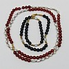 A freshwater pearl, yellow metal and Cornelian bead long necklet threaded onto fine metal chain