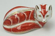 A Royal Crown Derby fox paperweight.