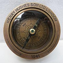 A Henry Hughes brass naval compass dated 1941