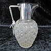 A cut glass claret jug with Christopher Dresser