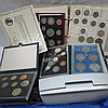 A collection of cased proof British coin sets,