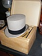 A Moss Bros top hat in original box