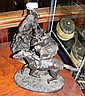 An antique style bronzed figure of jockey on