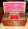 A casket shaped mahogany two compartment tea caddy