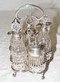 An Edwardian silver five bottle cruet on pierced