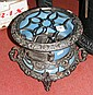 An early cast iron and enamel three burner