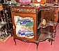 An Edwardian sideboard with central display