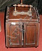 An antique coal scuttle with hinged door and