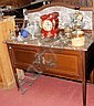 An Edwardian marble top washstand with cupboards