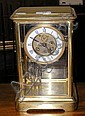 A 28cm high four glass mantel clock by Benson of