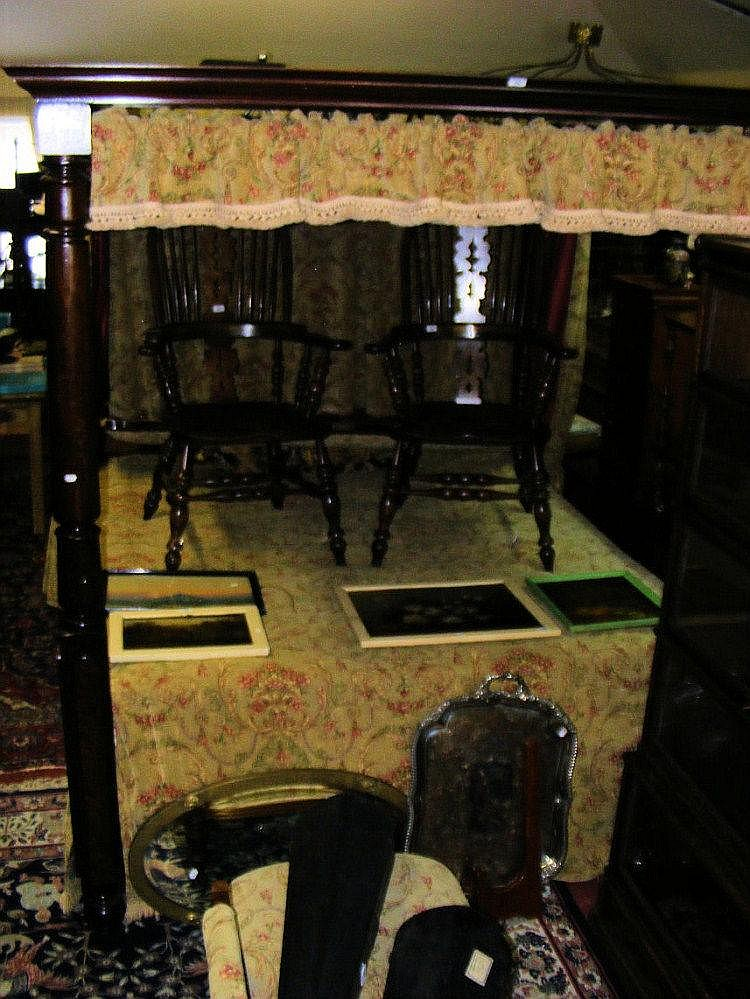 A mahogany four poster bed with matching pelmets,