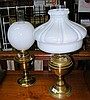 An old oil lamp with milk glass shade and one