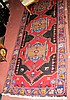 Middle Eastern rug with geometric border - 9.5ft x
