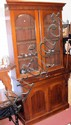 A Victorian mahogany bookcase with glazed upper