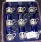 A set of nine silver and blue glass liqueur